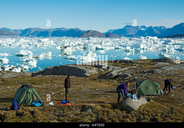 A trekking group camped by Sermilik Fjord, East Greenland - Stock Image