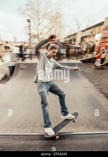 Skateboarding on mini ramp, 5-0 grind, Berlin, Germany - Stock Image