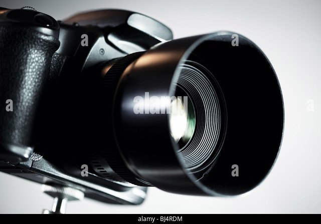 Professional DSLR camera on grey background. - Stock Image