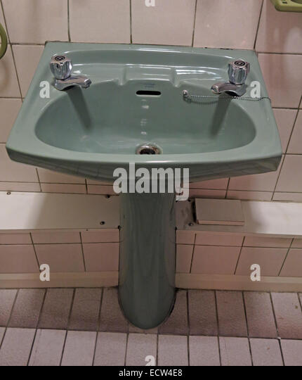 Classic 1970s 1980s green avocado bathroom suite Wash Hand Basin from England, Great Britain - Stock Image