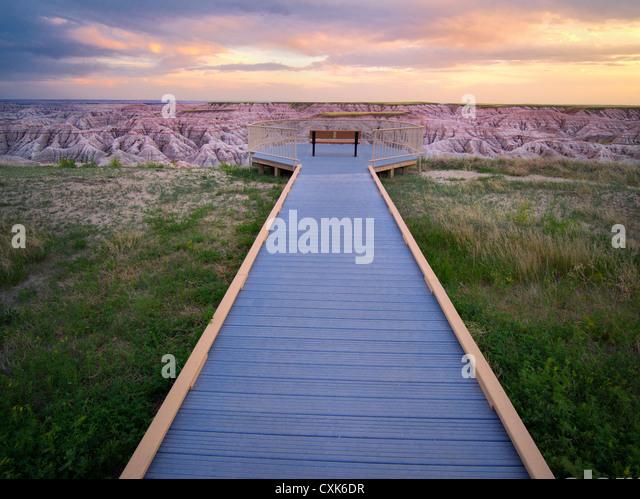Pathway and sunset in Badlands National Park, South Dakota. - Stock-Bilder