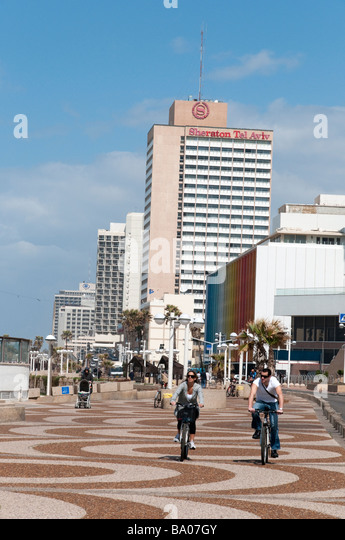 Cycling on the waterfront promenade Tel Aviv Israel - Stock Image