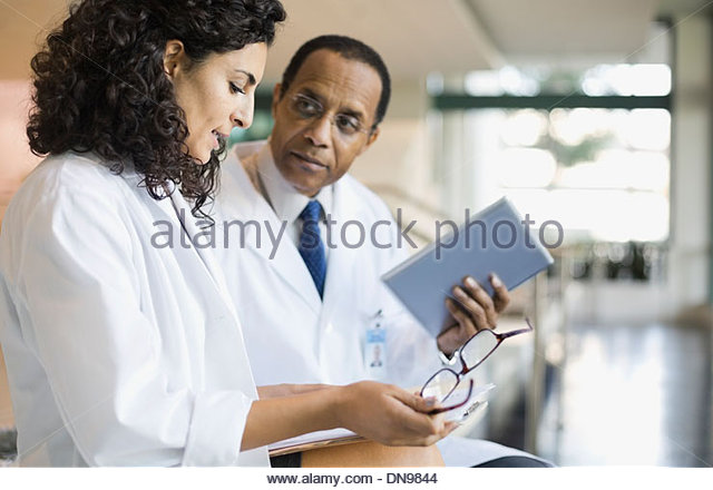 Doctors discussing medical results - Stock Image