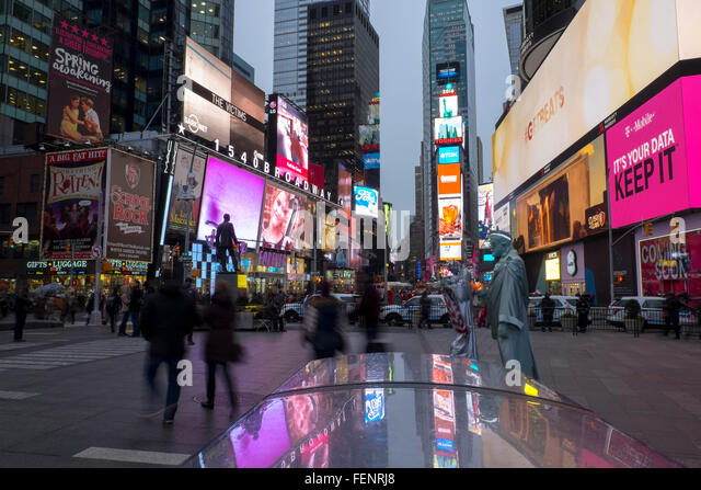 Advertising billboards at dusk, Times Square, New York, USA - Stock Image