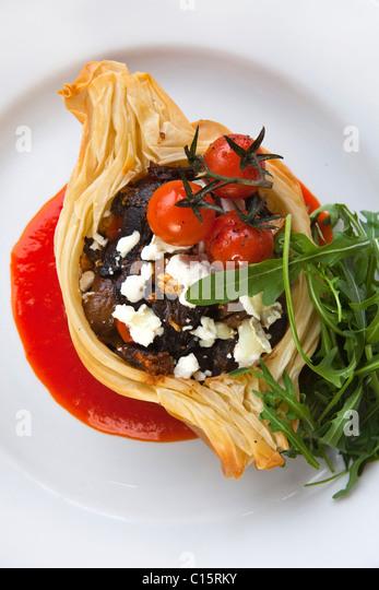 'main course' Wild mushroom, 'cherry tomato' & 'goat cheese' crispy 'filo tart' - Stock-Bilder