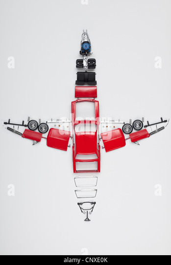 Parts of a model car arranged in the form of an airplane - Stock Image