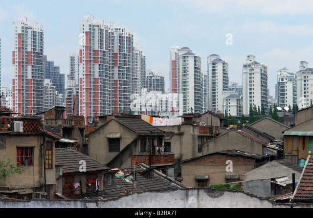 Old buildings against modern skyscrapers in Shanghai Shanghai Shi China Asia - Stock Image
