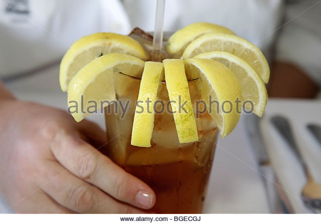 Savannah Georgia Historic District River Street Huey's New Orleans Style Restaurant iced tea cup many lemon - Stock Image