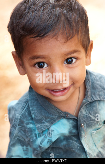 Smiling happy Indian village boy. Andhra Pradesh, India. Selective focus - Stock Image