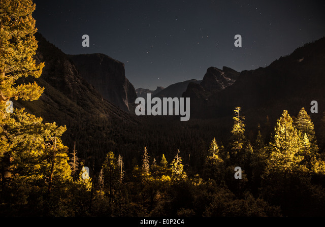 A night capture shows a view of Yosemite National Park - Stock Image