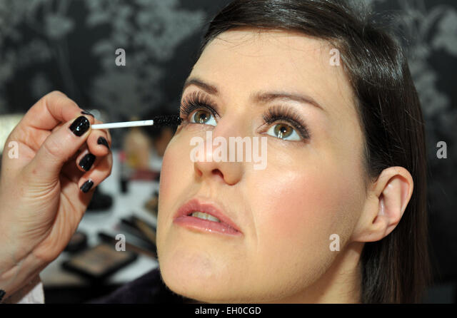 makeup applied to a bride on her wedding day MODEL RELEASED - Stock Image
