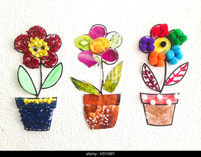 Three colorful pots made with recycled material by nursery children - Stock Image