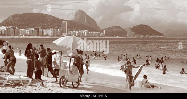 Brazil Rio de Janeiro Copacabana beach Cariocas background Poa de Acucar sugarloaf mountain - Stock Image