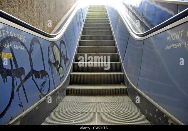 daub at a escalator, Germany, North Rhine-Westphalia, Cologne - Stock Image