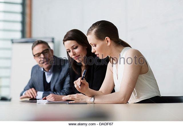 Three people in meeting - Stock Image