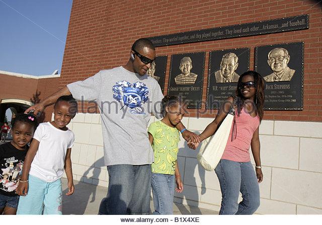 Arkansas North Little Rock Dickey Stephens Park minor league baseball Arkansas Travelers Black man woman girl father - Stock Image
