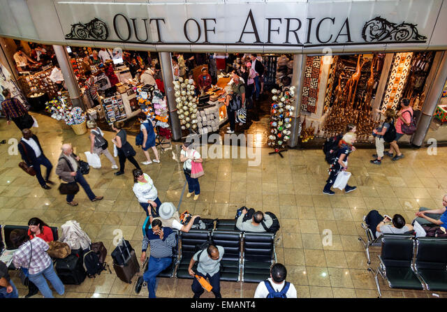 South Africa African Johannesburg O. R. Tambo International Airport terminal concourse gate area shopping business - Stock Image