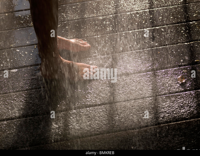 Standing In The Rain - Stock Image