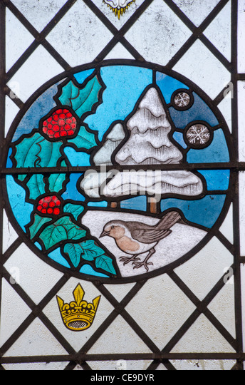 Stained glass window depicting the winter season, in the church of St Mary, Wortham, Suffolk, England, UK - Stock Image