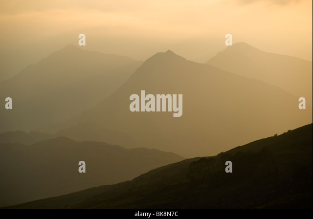 A hazy view of the Snowdon group from Capel Curig, Snowdonia, North Wales, UK - Stock Image