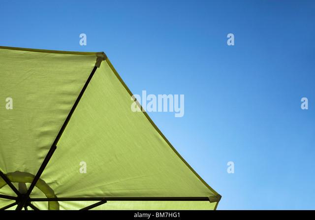 A beach umbrella, close-up, directly below - Stock Image