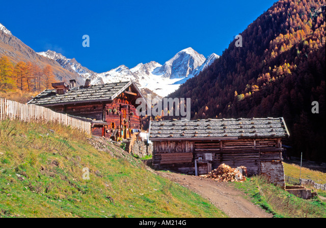 wooden hut near mountain - photo #26
