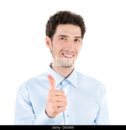 Close-up portrait of a successful handsome businessman who smiles and shows a thumb up gesture to camera. - Stock Image