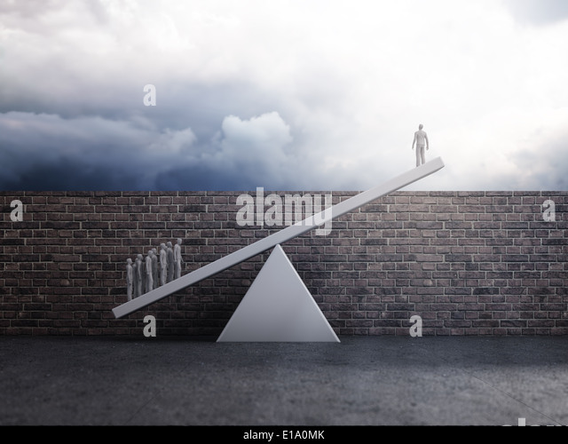 Group of people lifting a single person over a wall - team effort or inequality concept - Stock Image