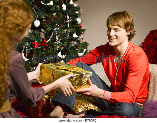 Man giving wife Christmas gift - Stock Image