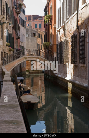 Venice, Italy; The Canal And A Bridge - Stock Image