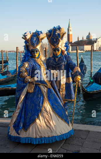 Two ladies in blue and gold masks, Venice Carnival, Venice, UNESCO World Heritage Site, Veneto, Italy, Europe - Stock Image
