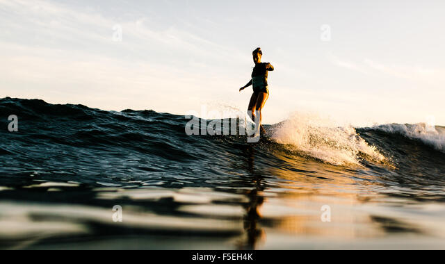 Woman surfing, Malibu, California, USA - Stock Image