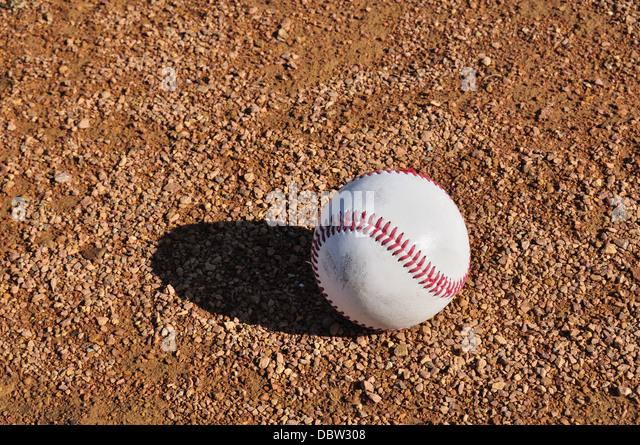 Baseball on the ground on a baseball diamond - Stock Image
