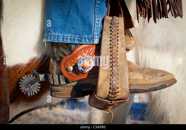 Boot with spurs in stirrup on ranch in eastern Wyoming - Stock-Bilder