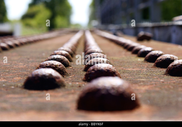 Rusty iron girder with studs - load bearing structure part of a rail bridge over water - Stock Image