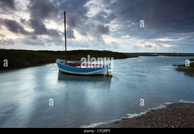 A moody and windy summer evening at Brancaster Staithe, North Norfolk, England, United Kingdom, Europe - Stock Image