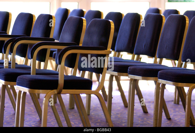 Photograph of rows seating wedding guests empty venue conference - Stock-Bilder