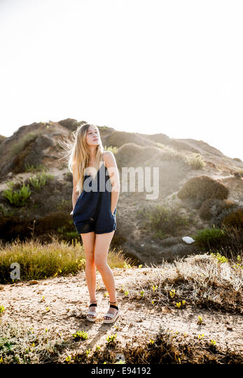 Young blond female model in casual clothes on a beach. Model released - Stock Image