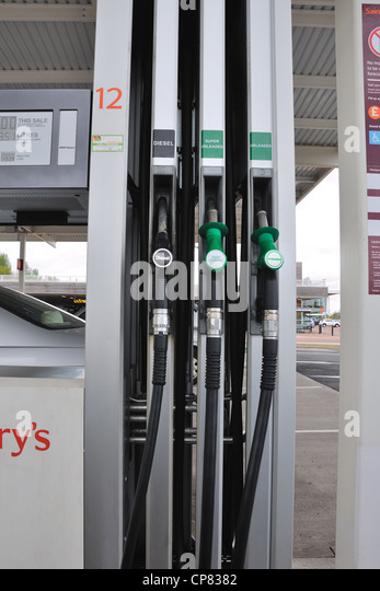 Petrol pump hoses for diesel, unleaded and super unleaded in a Sainsbury's  forecourt in Glasgow, Scotland, - Stock Image