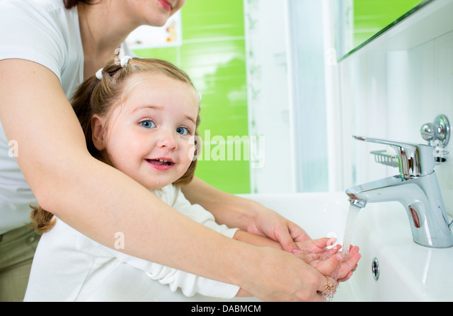 Mom Son Kitchen Sink Behind