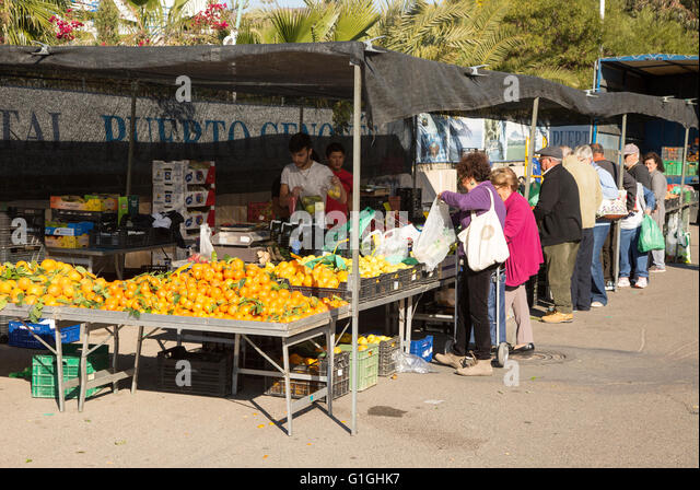 People buying fruit and vegetables at market stall, San Jose, Almeria, Spain - Stock Image
