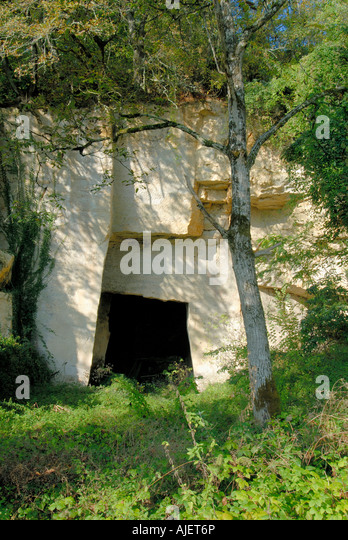 Man-made entrance to  underground storage cave in rockface, Vienne, France. - Stock Image