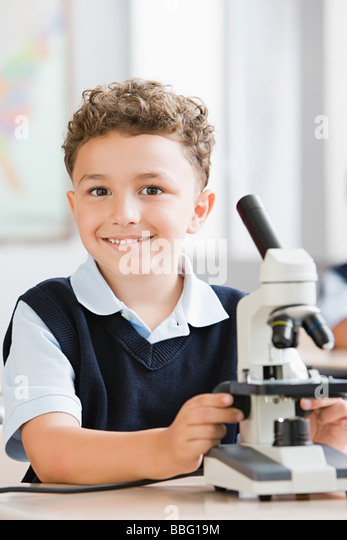 Schoolboy with microscope - Stock Image