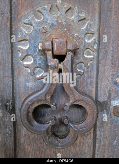 Antique door knocker,Montecute,South Somerset on wooden door - Stock Image