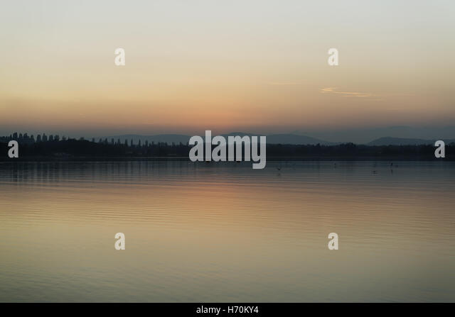 pastel colors at sunset on Lake Varese - Stock Image