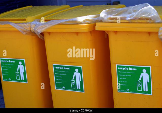 Row of yellow recycling bins at bird sanctuary. - Stock Image