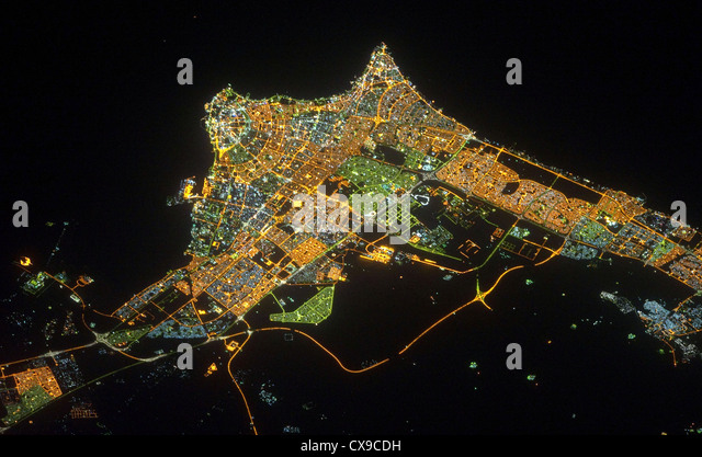 Kuwait City at night viewed from space - Stock Image
