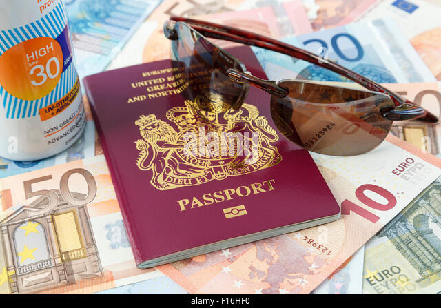 Travel things passport Euro currency suncream and sunglasses for travelling to Eurozone countries from UK for a - Stock-Bilder