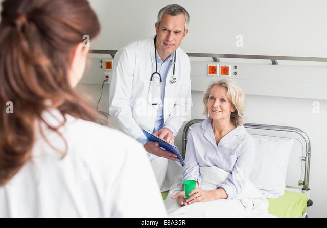 Doctors' visit in hospital - Stock Image
