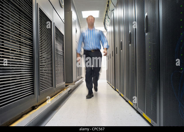 A technician maintaining the server room. - Stock Image